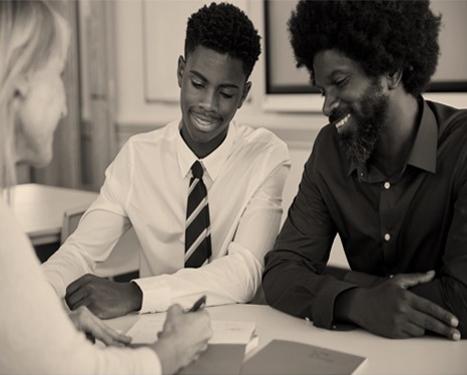 Boy with parent speaking to teacher